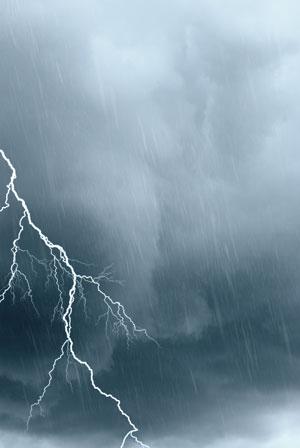 Black clouds and lightning strike